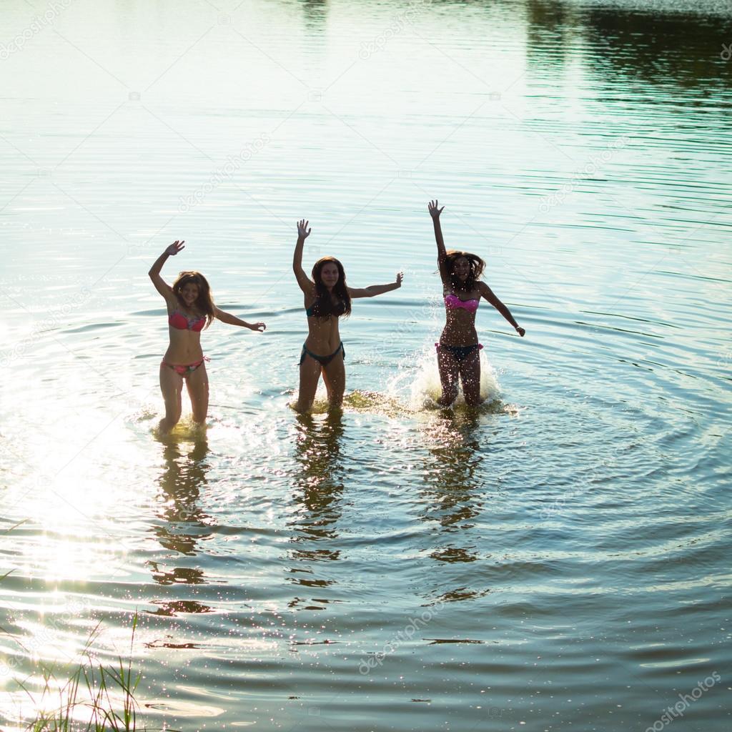 teenage girls having fun in water