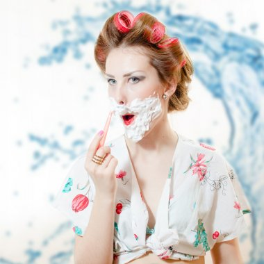 young pinup woman shaving face