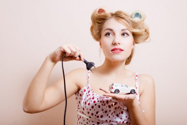 Housewife with charger for toy car
