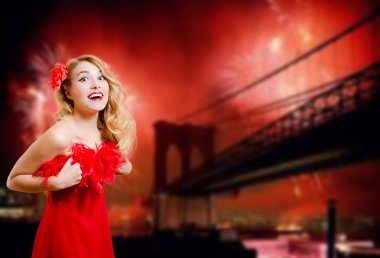 Pretty lady excited beside Brooklyn Bridge with fireworks at night