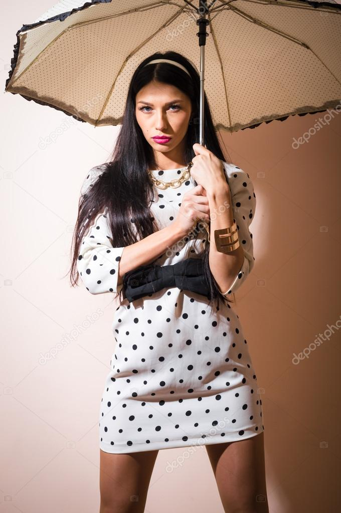 80ef4b2f4 Young happy pinup woman with umbrella wearing polka dot dress over white  background — Photo by ...