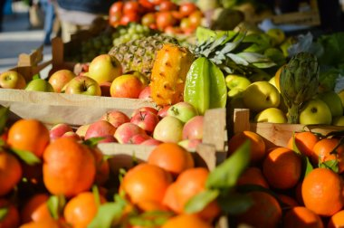 Buying and selling. Many different fruits at farmers market background.