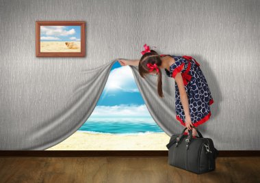 Child look at sea behind the wall, vacation concept