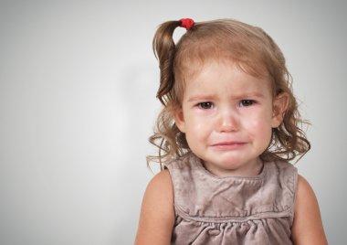 Portrait of sad crying baby girl