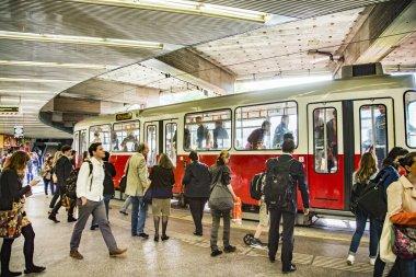 people waiting for streetcar at Schwedenplatz in Vienna