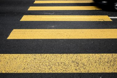 pederastian crossing in asphalt street and abstract background