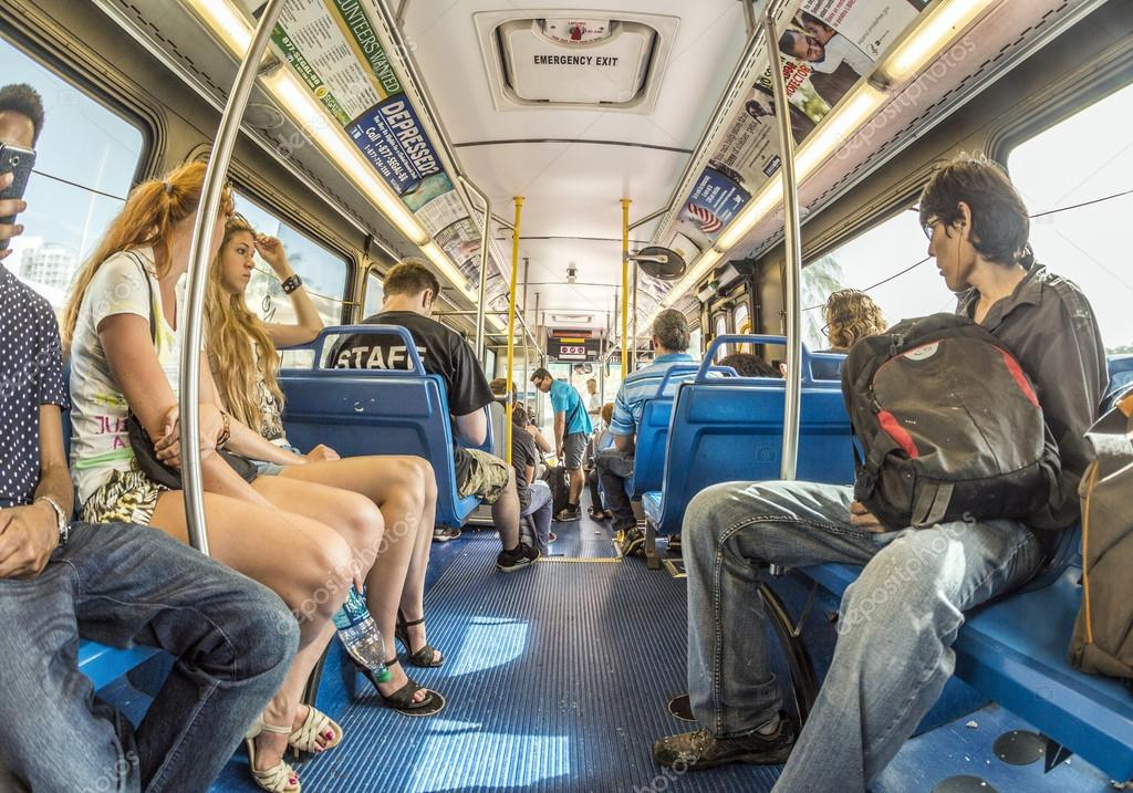 people in the downtown Metro bus in Miami, USA