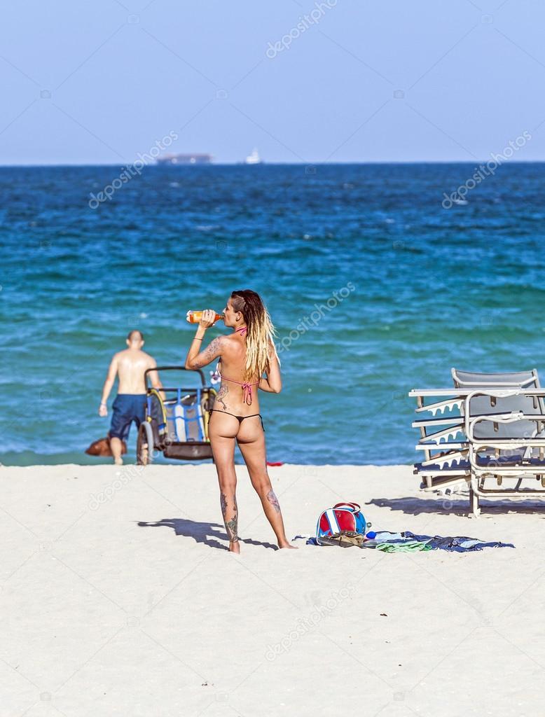 People Enjoy The Beautiful Beach At South Beach Miami Stock