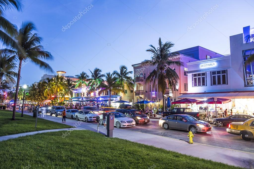 people enjoy night view at ocean drive in miami stock editorial