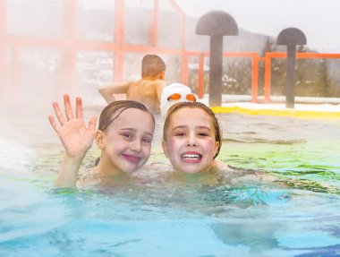 children having fun in the outdoor thermal pool