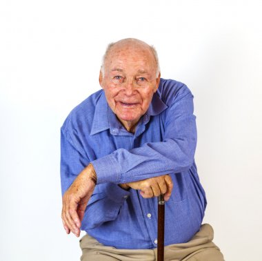happy elderly man sitting in a chair