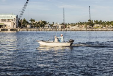 FORT LAUDERDALE, USA - AUG 20, 2014: man in boat for fishing by