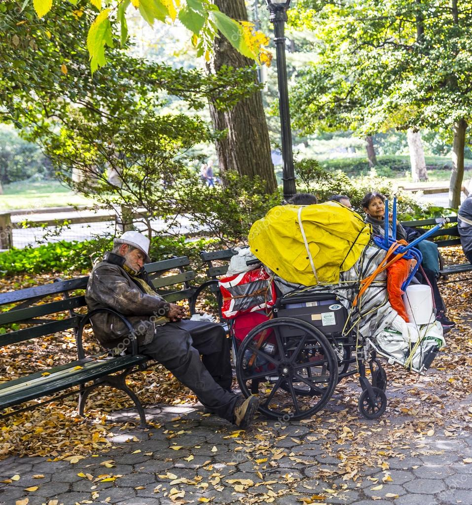 homeless man sleeping in central park   in Manhattan