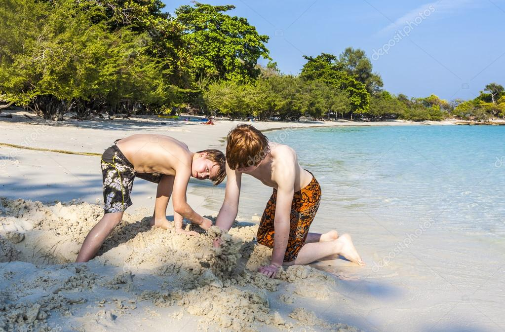 boys are playing at the  tropical beach with sand