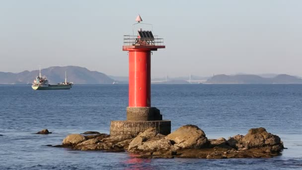 lighthouse with fishing boat