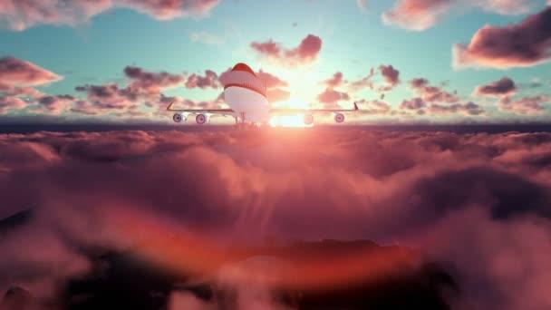 Boeing letadlo letí nad mraky při západu slunce