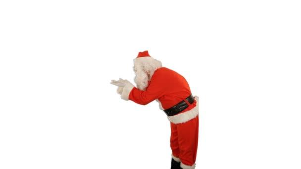 Santa Claus fouká magický prášek z jeho rukou, boční pohled, proti bílé