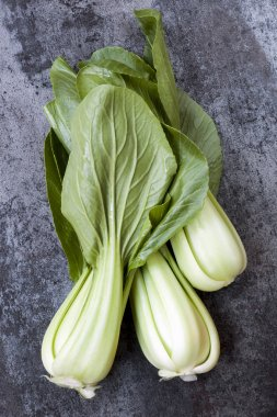 Bok Choi Top View over Dark Slate