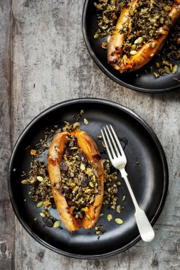 Baked Sweet Potatoes Stuffed With Wild Rice Seeds and Cranberrie