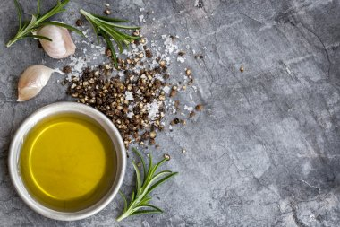 Food Background Olive Oil Salt Peppercorns Rosemary and Garlic o