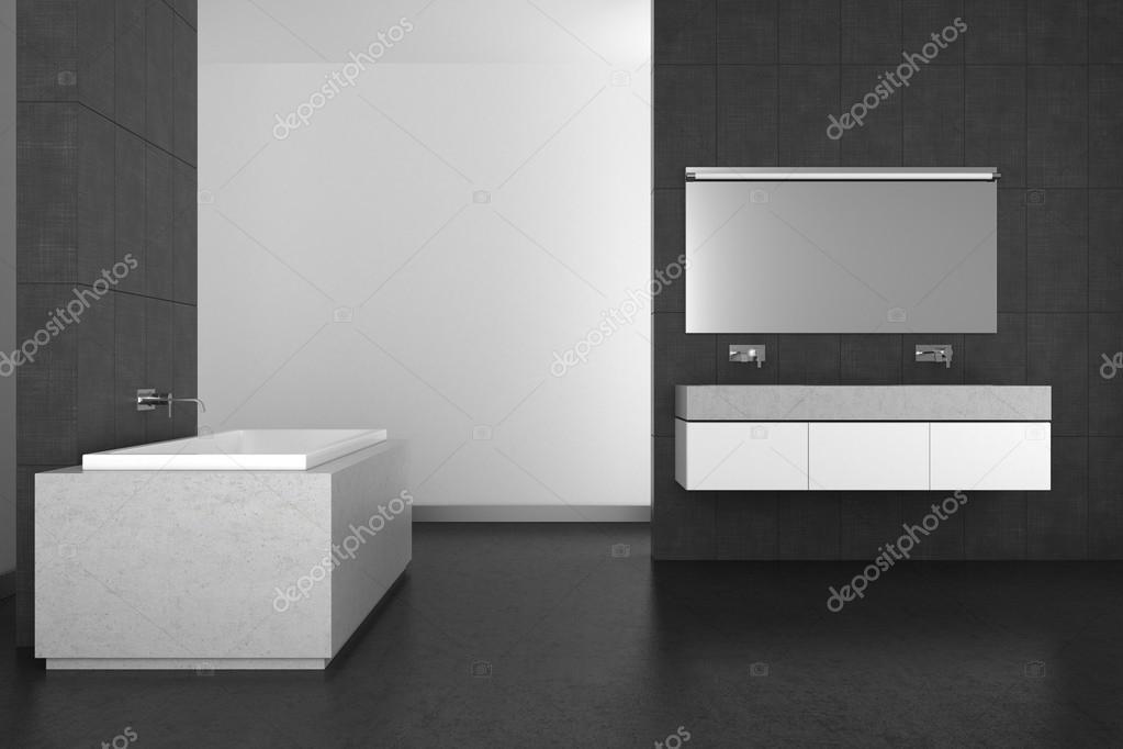 Moderne badkamer met grijze tegels en donkere vloer u stockfoto