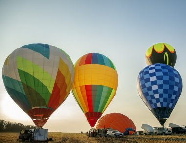 Balloons start fly on fields, hills in summer stock vector