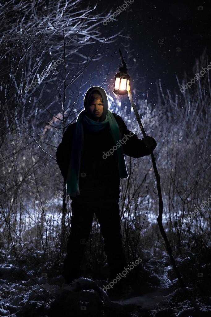 mysterious man came out  forest in the hand torch