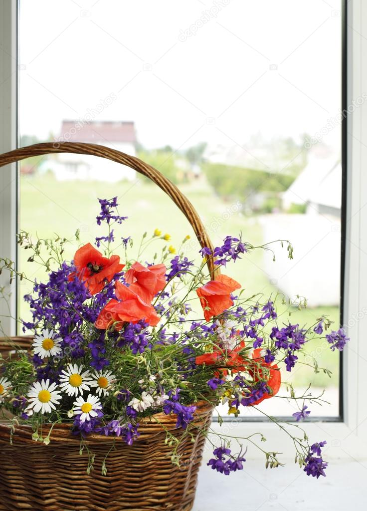 Bouquet of flowers on a plastic window