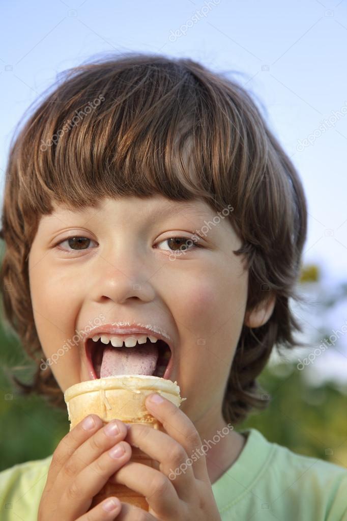 happy little boy eating an ice cream