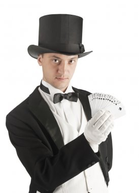 magician holding playing cards