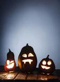 jack o lámpák halloween tök arc, fából készült háttér