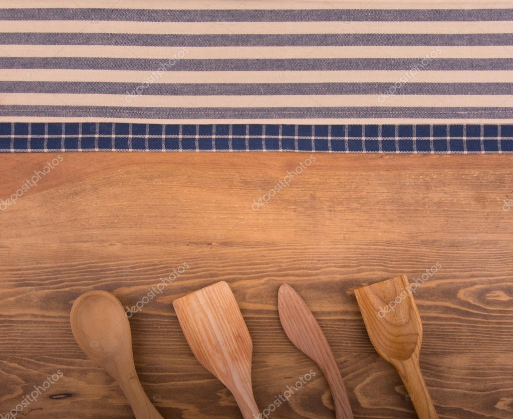 Blue and white kitchen towels - Blue And Off White Kitchen Towels On Dark Wood Background With Wooden Kitchen Utensils Stock Image