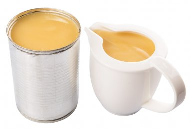 Condensed Milk In Tin Can And Milk Pitcher