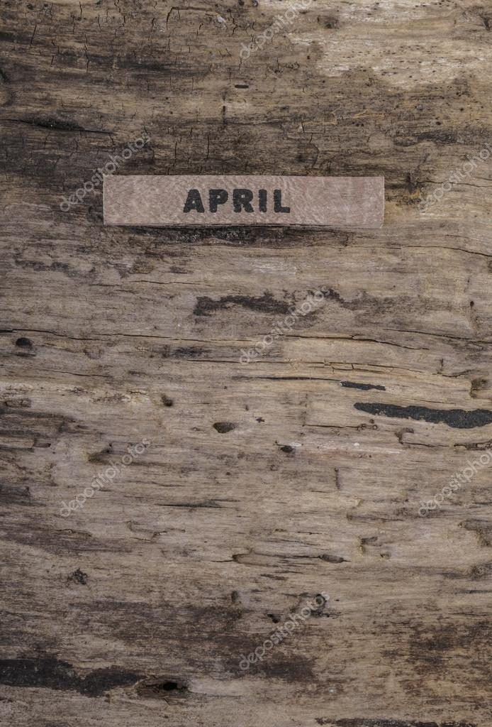 Template With Cube Calendar For April On Wood Stock Photo