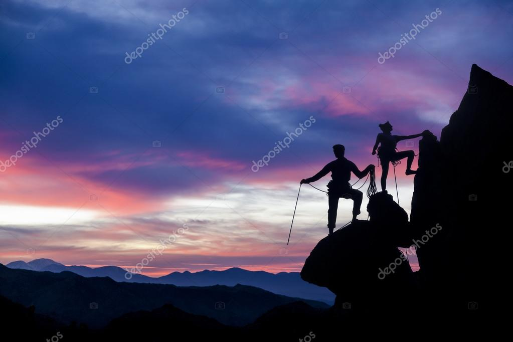 Climbing team on the edge.