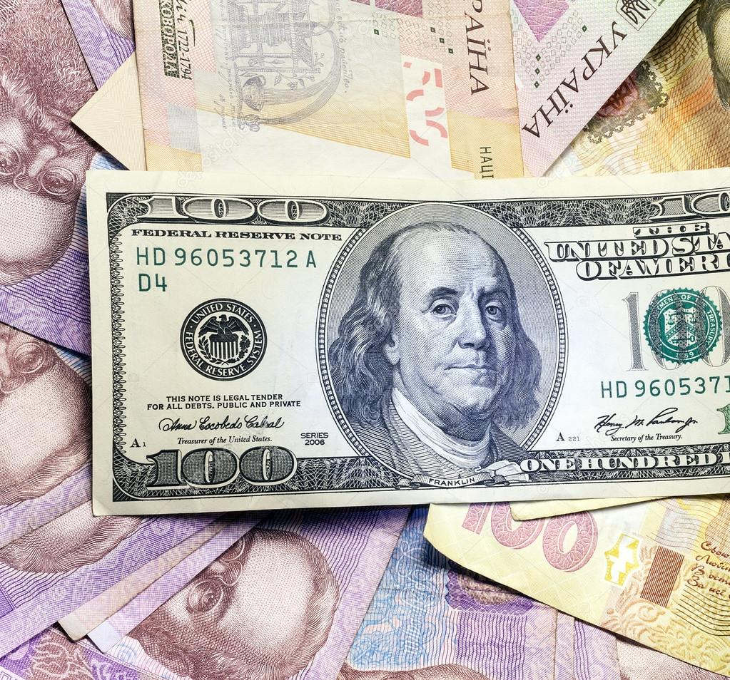 Background different banknotes of us dollars and Ukrainian hryvnia