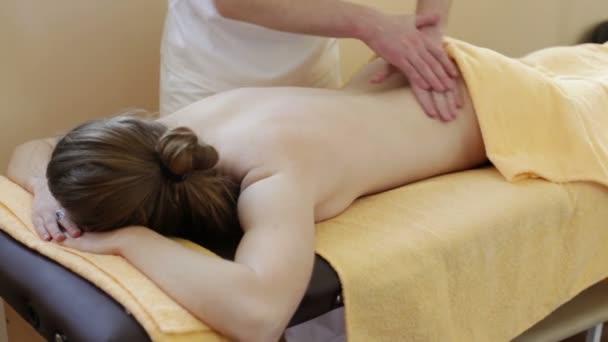 Massage. Manual therapist manipulates on woman's back