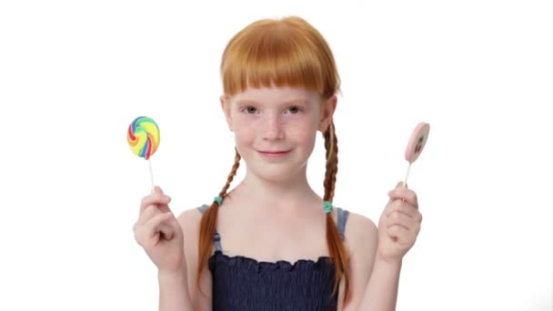 Little ginger girl with  lollypops