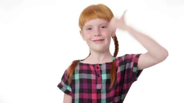 redhead girl with two pigtails is showing thumb up gesture