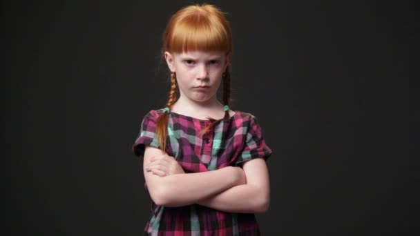 Sad ginger girl, she is looking displeased and offended