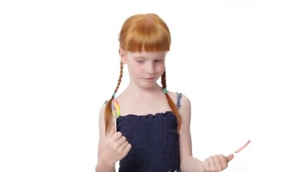 Little ginger girl with  lollypops