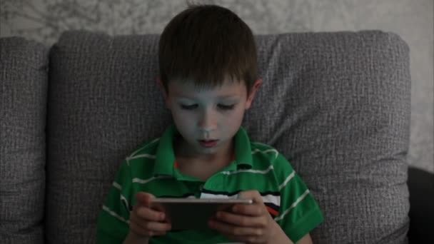 Little boy playing on a smartphone