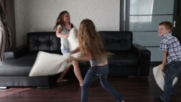 Pillow fight - three children