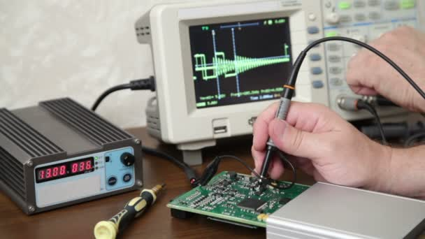 Engineer working with electronic devices