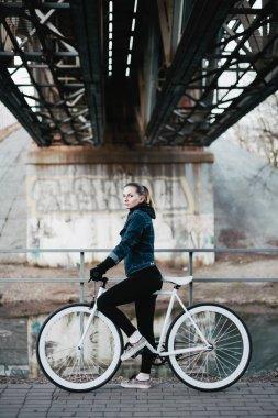 Beautiful girl on a bicycle urban
