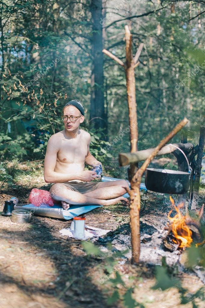 Hippie man cooking on fire