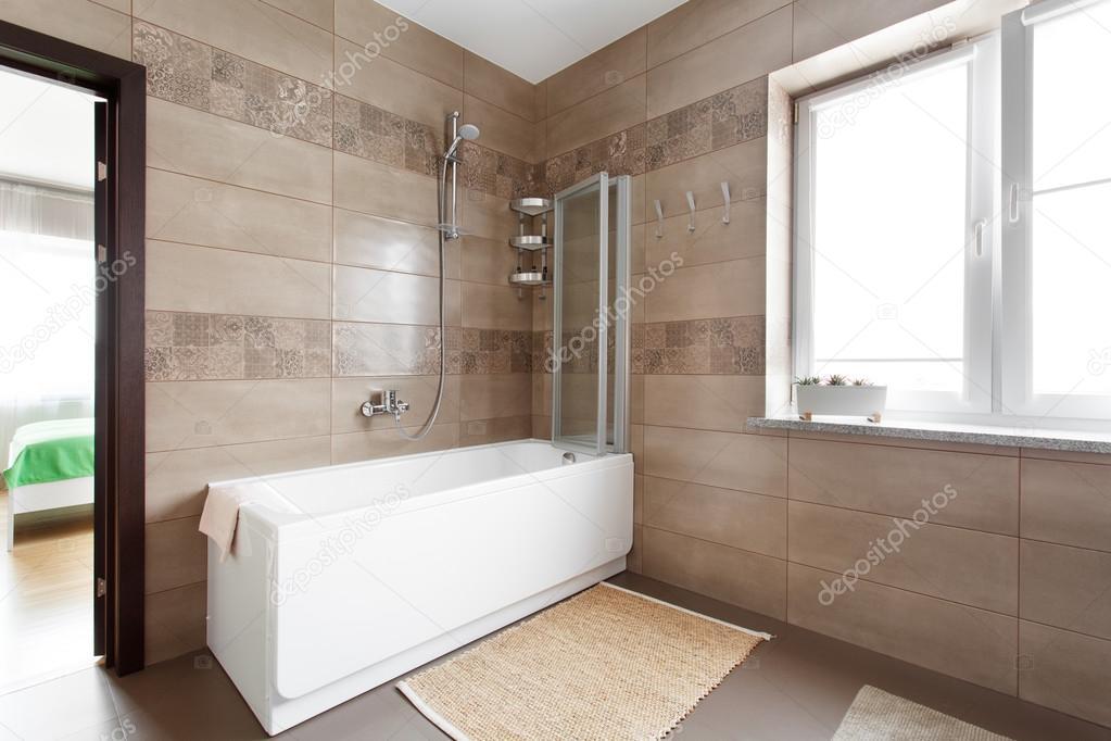 White bathtub in large bathroom — Stock Photo © yuryRumovsky #119906514