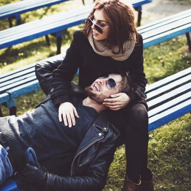 Cheerful couple relaxing in the park