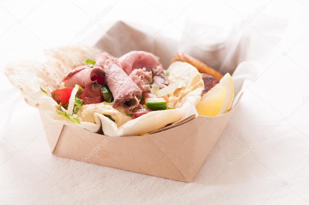 Lamb shawarma take out meal in a box