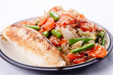 Pan seared tilapia fish filet with rice stir fry